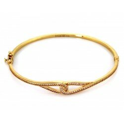 Złota sztywna bransoleta węzeł z cyrkoniami